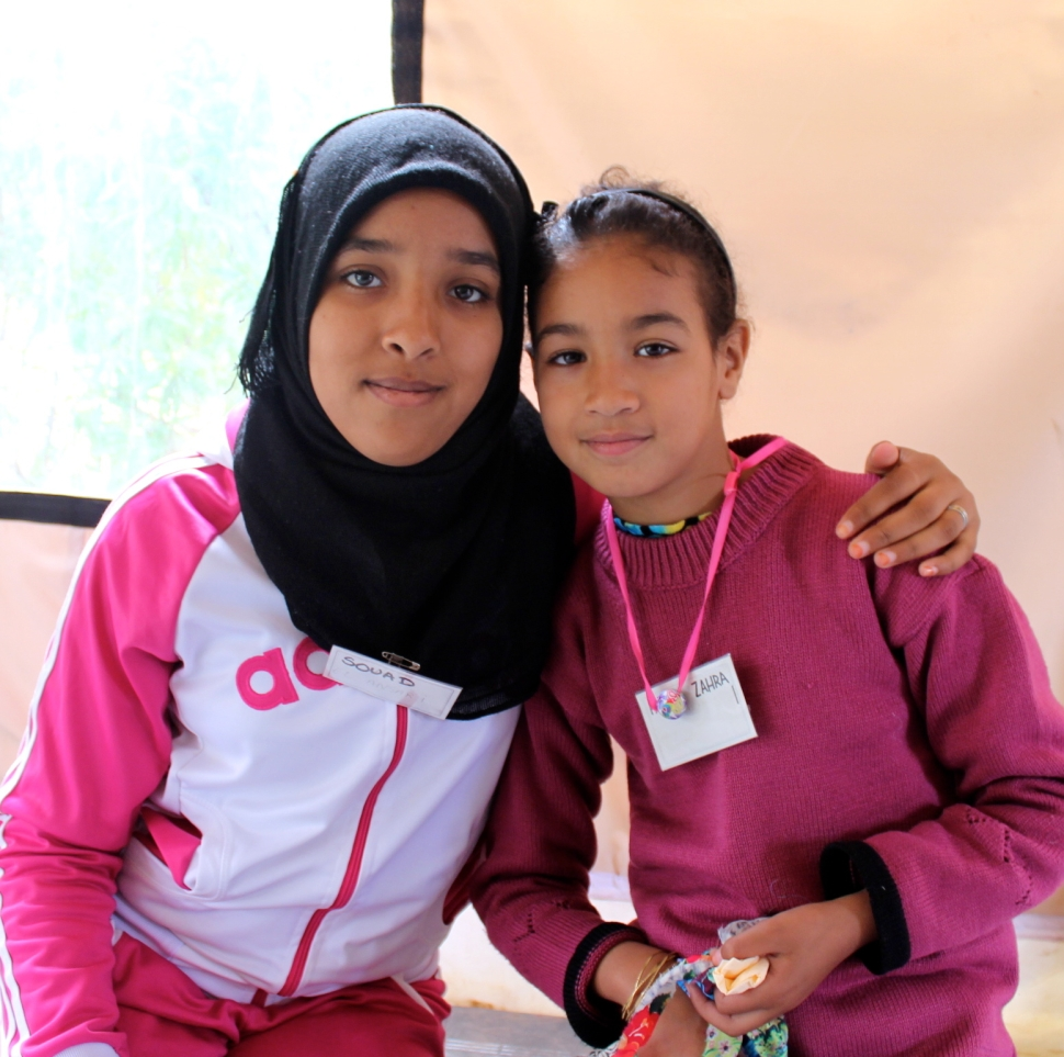 "Souad (left) is thirteen. She said she has been coming since Ramadan in August : ""I've learned to make kites and bowls.  I've learned how to play sports and health information from the doctor who comes when we take yoga."""